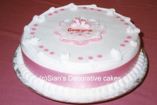 baptism cake with pink bib - Decorative Cakes